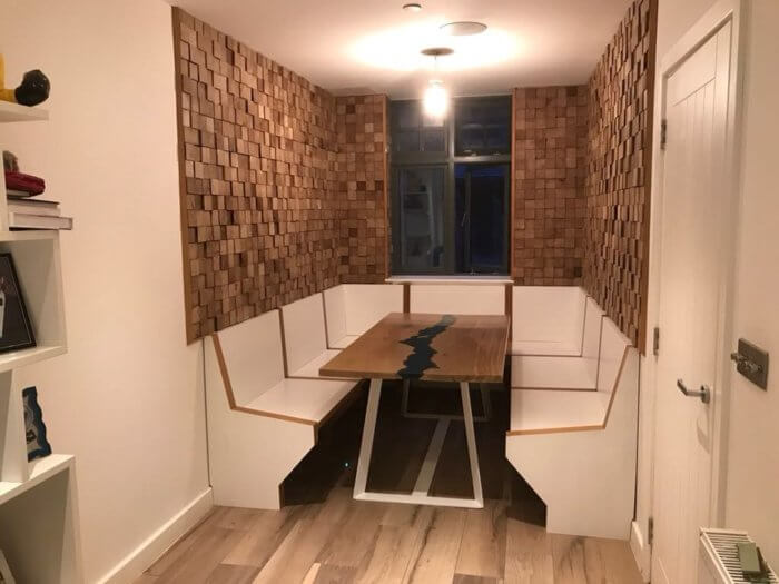 Bespoke hand made walnut paneling, plus an oak resin table infilled with a lake of the customer