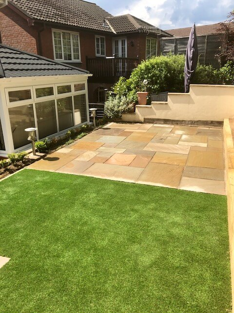 new Indian sandstone patio and luxury grade artificial grass